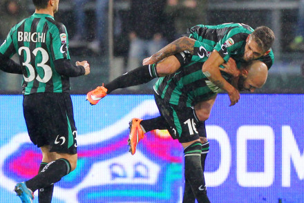 ROME, ITALY - DECEMBER 06:  Simone Zaza (R) with his team-mate Domenico Berardi and Matteo Brighi (R) of US Sassuolo Calcio celebrate after scoring the second goal during the Serie A match between AS Roma and US Sassuolo Calcio at Stadio Olimpico on December 6, 2014 in Rome, Italy.  (Photo by Paolo Bruno/Getty Images)