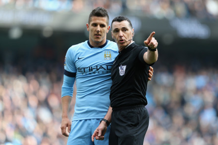 MANCHESTER, ENGLAND - MARCH 21: Stevan Jovetic of Manchester City speaks to Referee Neil Swarbrick  during the Barclays Premier League match between Manchester City and West Bromwich Albion at Etihad Stadium on March 21, 2015 in Manchester, England.  (Photo by Jan Kruger/Getty Images)