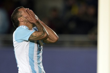 Argentina's forward Carlos Tevez reacts during the 2015 Copa America football championship match against Paraguay in La Serena, Chile, on June 13, 2015. The match ended 2-2.   AFP PHOTO / JUAN MABROMATA        (Photo credit should read JUAN MABROMATA/AFP/Getty Images)