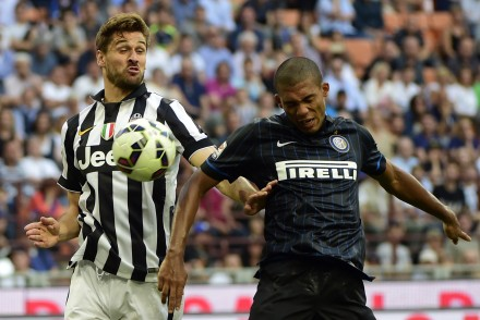 Juventus' forward from Spain Fernando Llorente (L) fights for the ball with Inter Milan's defender from Brazil Jesus during the Italian Serie A football match Inter Milan vs Juventus on May 16, 2015 at the San Siro Stadium stadium in Milan. AFP PHOTO / OLIVIER MORIN        (Photo credit should read OLIVIER MORIN/AFP/Getty Images)