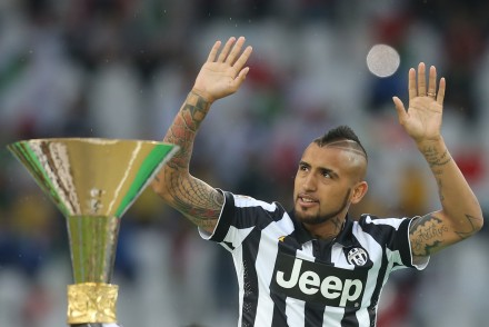Juventus' midfielder from Chile Arturo Vidal celebrates during a medal ceremony following the Italian Serie A football match Juventus vs Napoli on May 23, 2015 at the Juventus stadium in Turin. Juventus won the Coppa Italia on May 20, 2015 and the Italian League today after their 3-1 victory over Napoli.  AFP PHOTO / MARCO BERTORELLO        (Photo credit should read MARCO BERTORELLO/AFP/Getty Images)