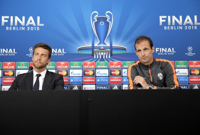"Juventus' midfielder Claudio Marchisio (L) and Juventus' coach Massimiliano Allegri give a press conference five days before the final of the UEFA Champions League football match Juventus Vs Barcelona on June 1, 2015 at the ""Juventus Stadium"" in Turin.  AFP PHOTO / MARCO BERTORELLO        (Photo credit should read MARCO BERTORELLO/AFP/Getty Images)"
