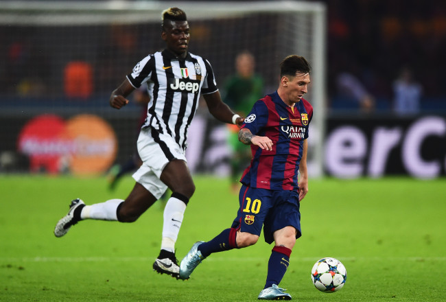 BERLIN, GERMANY - JUNE 06: Lionel Messi of Barcelona goes past Paul Pogba of Juventus during the UEFA Champions League Final between Juventus and FC Barcelona at Olympiastadion on June 6, 2015 in Berlin, Germany.  (Photo by Laurence Griffiths/Getty Images)