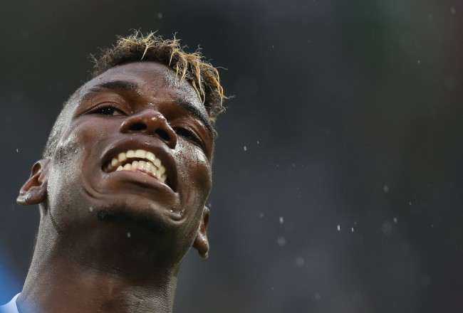 "Juventus' midfielder from France, Paul Pogba reacts during the Italian Serie A football match Juventus Vs Udinese on August 23, 2015 at the ""Juventus Stadium"" in Turin.  AFP PHOTO / MARCO BERTORELLO        (Photo credit should read MARCO BERTORELLO/AFP/Getty Images)"