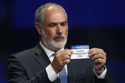 Former FC Barcelona player Andoni Zubizarreta shows the name of Juventus Turin during the UEFA Champions League Group stage draw ceremony, on August 27, 2015 in Monaco. AFP PHOTO / VALERY HACHE        (Photo credit should read VALERY HACHE/AFP/Getty Images)