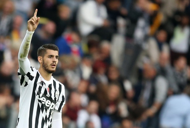 "Juventus' forward Alvaro Morata from Spain celebrates after scoring during the Italian Serie A  football match Juventus Vs Bologna on October 4, 2015 at the ""Juventus Stadium"" in Turin.  AFP PHOTO / MARCO BERTORELLO        (Photo credit should read MARCO BERTORELLO/AFP/Getty Images)"