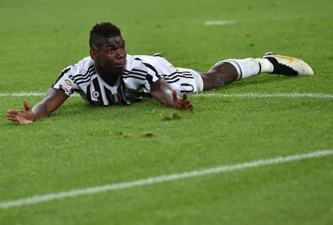 TURIN, ITALY - OCTOBER 04:  Paul Pogba of Juventus FC looks on during the Serie A match between Juventus FC and Bologna FC at Juventus Arena on October 4, 2015 in Turin, Italy.  (Photo by Valerio Pennicino/Getty Images)