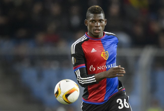 Basel's Swiss forward Breel Embolo controls the ball during the UEFA Europa League football match between FC Basel and KKS Lech Poznan at St. Jakob Park stadium in Basel on October 1, 2015. AFP PHOTO / FABRICE COFFRINI        (Photo credit should read FABRICE COFFRINI/AFP/Getty Images)