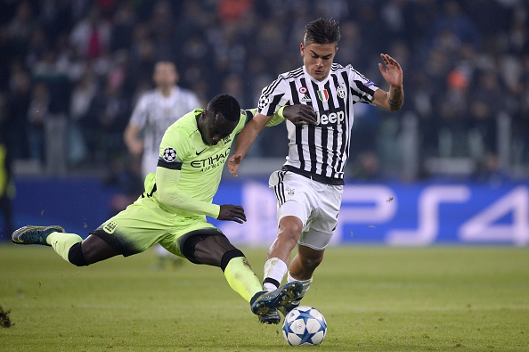 Manchester City's French defender Bacary Sagna (L) tackles Juventus' forward from Argentina Paulo Dybala during the UEFA Champions League football match Juventus vs Manchester City on November 25, 2015 at the Juventus Stadium in Turin.        / AFP / MARCO BERTORELLO        (Photo credit should read MARCO BERTORELLO/AFP/Getty Images)