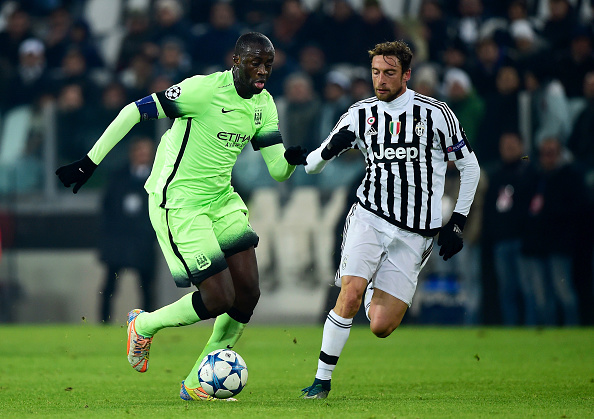 TURIN, ITALY - NOVEMBER 25:  Yaya Toure of Manchester City is closed down by Claudio Marchisio of Juventus during the UEFA Champions League group D match between Juventus and Manchester City FC at the Juventus Stadium on November 25, 2015 in Turin, Italy.  (Photo by Mike Hewitt/Getty Images)