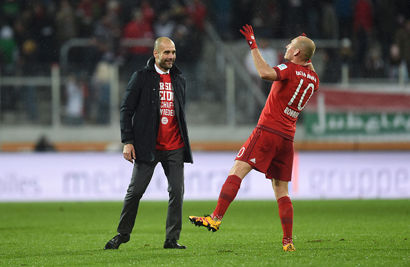 Bayern Munich's Spanish headcoach Pep Guardiola (L) jokes with Bayern Munich's Dutch midfielder Arjen Robben after the German first division Bundesliga football match of FC Augsburg vs FC Bayern Munich in Augsburg, southern Germany, on February 14, 2016. / AFP / CHRISTOF STACHE / RESTRICTIONS: DURING MATCH TIME: DFL RULES TO LIMIT THE ONLINE USAGE TO 15 PICTURES PER MATCH AND FORBID IMAGE SEQUENCES TO SIMULATE VIDEO. == RESTRICTED TO EDITORIAL USE == FOR FURTHER QUERIES PLEASE CONTACT DFL DIRECTLY AT + 49 69 650050         (Photo credit should read CHRISTOF STACHE/AFP/Getty Images)