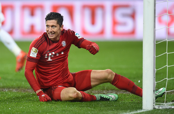 Bayern Munich's Polish striker Robert Lewandowski reacts during the German first division Bundesliga football match FC Augsburg 1907 and FC Bayern Munich in the stadium in Augsburg, on February 14, 2016.   / AFP / CHRISTOF STACHE        (Photo credit should read CHRISTOF STACHE/AFP/Getty Images)