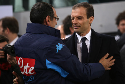 Napoli's coach Maurizio Sarri (L) hugs Juventus' coach Massimiliano Allegri during the Italian Serie A football match Juventus vs Napoli at Juventus Stadium in Turin on February 13, 2016. / AFP / MARCO BERTORELLO        (Photo credit should read MARCO BERTORELLO/AFP/Getty Images)