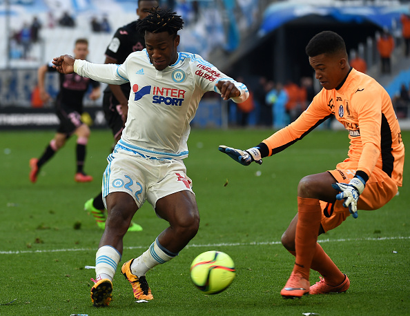 Marseille's Belgian forward Michy Batshuayi (L) vies with Toulouse's goalkeeper Alban Lafont (R) during the French L1 football match between Marseille and Toulouse on March 6, 2016 at the Velodrome stadium in Marseille, southern France. AFP PHOTO / ANNE-CHRISTINE POUJOULAT / AFP / ANNE-CHRISTINE POUJOULAT (Photo credit should read ANNE-CHRISTINE POUJOULAT/AFP/Getty Images)