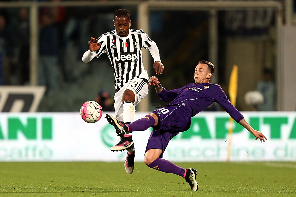 FLORENCE, ITALY - APRIL 24: Patrice Evra of Juventus FC in action against Federico Bernardeschi of ACF Fiorentina during the Serie A match between ACF Fiorentina and Juventus FC at Stadio Artemio Franchi on April 24, 2016 in Florence, Italy.  (Photo by Gabriele Maltinti/Getty Images)