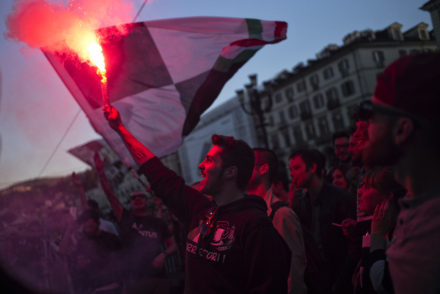 """Juventus supporters celebrate after their football club won the Italian Serie A """"Scudetto"""" in Piazza San Carlo in Turin on April 25, 2016. Defending champions Juventus mathematically secured a record-equalling fifth consecutive Serie A title today after Roma stunned second-placed Napoli with a last-gasp winner. Juventus won their fifth consecutive and 34th official Serie A title./ AFP / MARCO BERTORELLO        (Photo credit should read MARCO BERTORELLO/AFP/Getty Images)"""