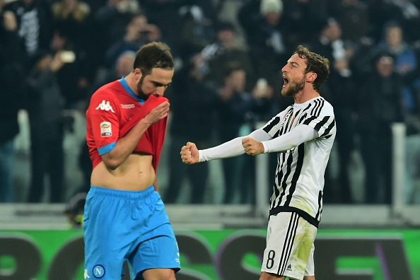 """Juventus' midfielder from Italy Claudio Marchisio (R) celebrates in front of Napoli's forward from Argentina Gonzalo Higuain at the end of the Italian Serie A  football match Juventus Vs Napoli on February 13, 2016 at the """"Juventus Stadium"""" in Turin. / AFP / GIUSEPPE CACACE        (Photo credit should read GIUSEPPE CACACE/AFP/Getty Images)"""