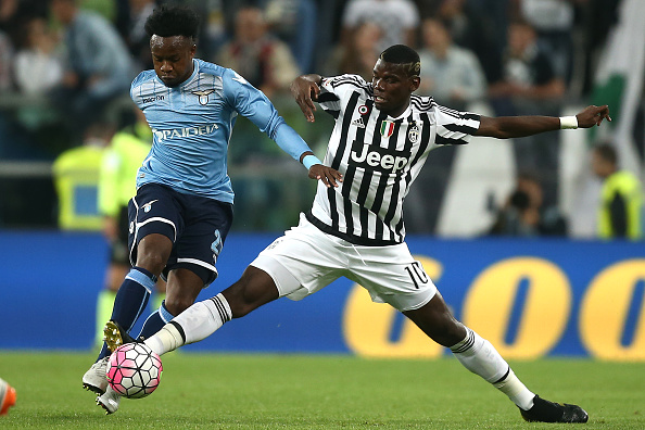 """Lazio's midfielder Ogenyi Eddy Onazi of Nigeria (L) fights for the ball with Juventus' midfielder Paul Pogba from France during the Italian Serie A football match Juventus Vs Lazio on April 20, 2016 at the """"Juventus Stadium"""" in Turin. / AFP / MARCO BERTORELLO (Photo credit should read MARCO BERTORELLO/AFP/Getty Images)"""
