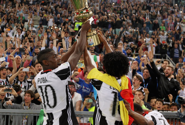 ROME, ITALY - MAY 21:  Juventus FC players celebrate with the trophy after winning the TIM Cup final match against AC Milan at Stadio Olimpico on May 21, 2016 in Rome, Italy.  (Photo by Paolo Bruno/Getty Images)