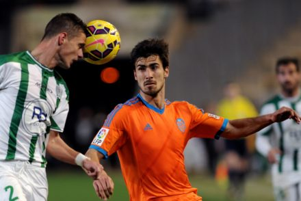 Cordoba's Serbian defender Aleksandar Pantic (L) vies with Valencia's Portuguese midfielder Andre Gomes (R)  during the Spanish league football match Cordoba CF vs Valencia CF at The Nuevo Arcangel stadium in Cordoba, on February 21, 2015. AFP PHOTO / CRISTINA QUICLER        (Photo credit should read CRISTINA QUICLER/AFP/Getty Images)