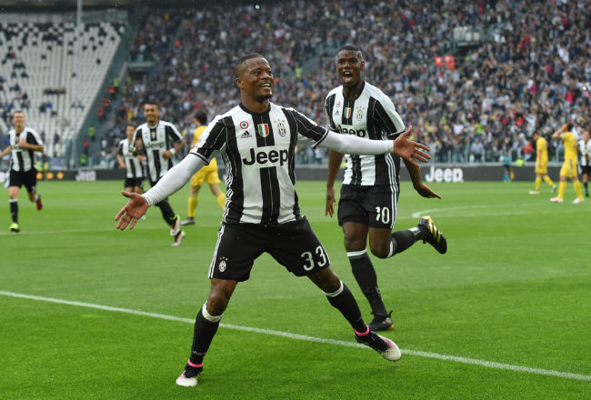 TURIN, ITALY - MAY 14:  Patrice Evra (L) of Juventus FC celebrates after scoring the opening goal during the Serie A match between Juventus FC and UC Sampdoria at Juventus Arena on May 14, 2016 in Turin, Italy.  (Photo by Valerio Pennicino/Getty Images)