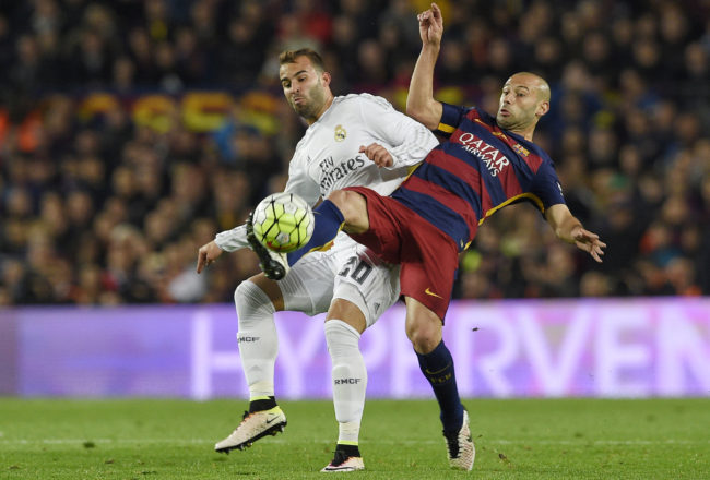 """Barcelona's Argentinian defender Javier Mascherano (R) vies with Real Madrid's forward Jese Rodriguez during the Spanish league """"Clasico"""" football match FC Barcelona vs Real Madrid CF at the Camp Nou stadium in Barcelona on April 2, 2016. / AFP / LLUIS GENE        (Photo credit should read LLUIS GENE/AFP/Getty Images)"""