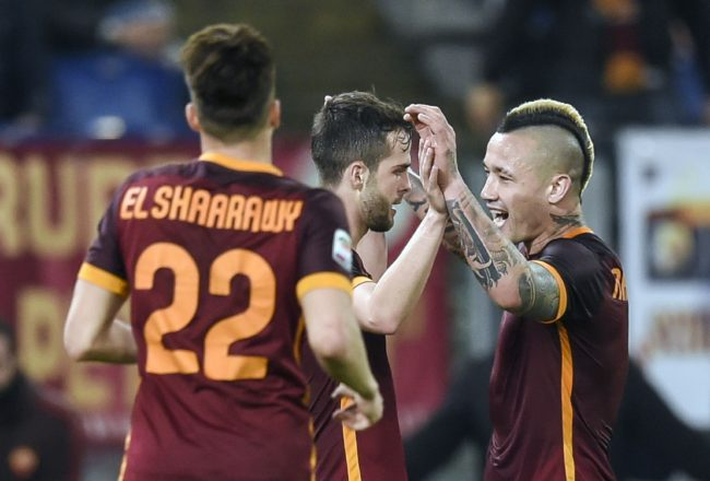 Roma's Bosnian midfielder Miralem Pjanic (C) celebrates with teammates Roma's midfielder from Belgium Radja Nainggolan after scoring against Frosinone during the Italian Serie A football match between AS Roma and Frosinone at Rome's Olympic stadium on January 30, 2016.  / AFP / ANDREAS SOLARO        (Photo credit should read ANDREAS SOLARO/AFP/Getty Images)
