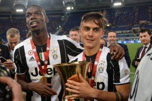 Argentina Paulo Dybala (R) and Juventus' midfielder from France Paul Pogba celebrate with the trophy after winning the Italian Tim Cup