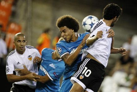 Zenit's Belgian midfielder Axel Witsel (L) vies with Valencia's midfielder Dani Parejo during the UEFA Champions League group H football match Valencia CF vs FC Zenit at the Mestalla stadium in Valencia on September 16, 2015. AFP PHOTO/ JOSE JORDAN        (Photo credit should read JOSE JORDAN/AFP/Getty Images)