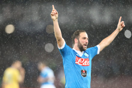 Napoli's Argentinian-French forward Gonzalo Higuain celebrates after scoring his 36th goal in the season, breaking the Italian record of 35 scores established in 1949-50 season by Ac Milan's Swedish forward Gunnar Nordahl, during the Italian Serie A football match SSC Napoli vs Frosinone Calcio on May 14 2016 at the San Paolo stadium in Naples. / AFP / CARLO HERMANN        (Photo credit should read CARLO HERMANN/AFP/Getty Images)