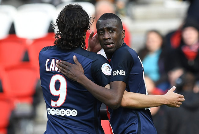 Paris Saint-Germain's French midfielder Blaise Matuidi (R) is congratulated by his teammate, Uruguyan forward Edinson Cavani after scoring a goal during the French L1 football match between Paris Saint-Germain and Caen at the Parc des Princes stadium in Paris on April 16, 2016.  / AFP / FRANCK FIFE        (Photo credit should read FRANCK FIFE/AFP/Getty Images)
