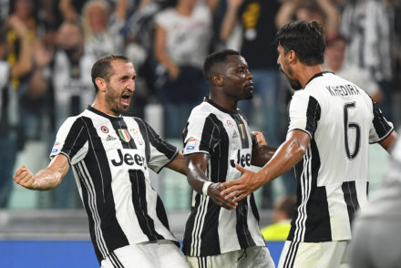 TURIN, ITALY - AUGUST 20:  Sami Khedira (R) of Juventus FC celebrates after scoring the opening goal with team mates Giorgio Chiellini (R) and Kwadwo Asamoah during the Serie A match between Juventus FC and ACF Fiorentina at Juventus Arena on August 20, 2016 in Turin, Italy.  (Photo by Valerio Pennicino/Getty Images)