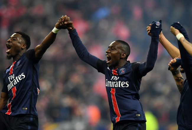 Paris Saint-Germain's Ivorian defender Serge Aurier (L) and Paris Saint-Germain's French midfielder Blaise Matuidi after winning the French League Cup final football match against Lille on April 23, 2016 at the Stade de France in Saint-Denis, north of Paris.  AFP PHOTO / FRANCK FIFE / AFP / FRANCK FIFE        (Photo credit should read FRANCK FIFE/AFP/Getty Images)