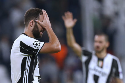 Juventus' Argentinian forward Gonzalo Higuain  reacts at the end of the UEFA Champions League football match between Juventus and Sevilla at the Juventus Stadium in Turin on September 14, 2016.   / AFP / MARCO BERTORELLO        (Photo credit should read MARCO BERTORELLO/AFP/Getty Images)