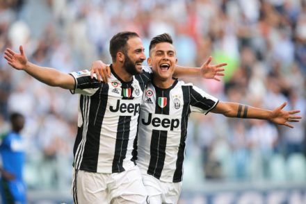 Juventus' Argentinian forward Gonzalo Higuain (L) celebrates with teammate Argentinian forward Paulo Dybala after scoring a goal during the Italian Serie A football match between Juventus and Sassuolo on September 10, 2016 at the Juventus Stadium in Turin.  / AFP / MARCO BERTORELLO        (Photo credit should read MARCO BERTORELLO/AFP/Getty Images)
